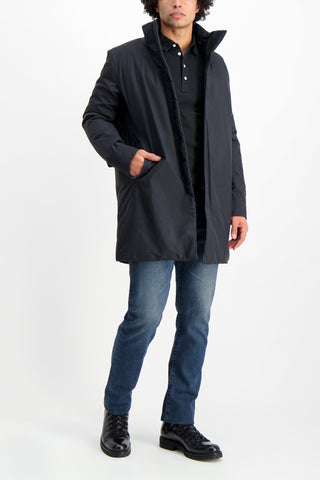 Full Body Image Of Model Wearing Arc'teryx Veilance Euler Long Sleeve Coat In Black