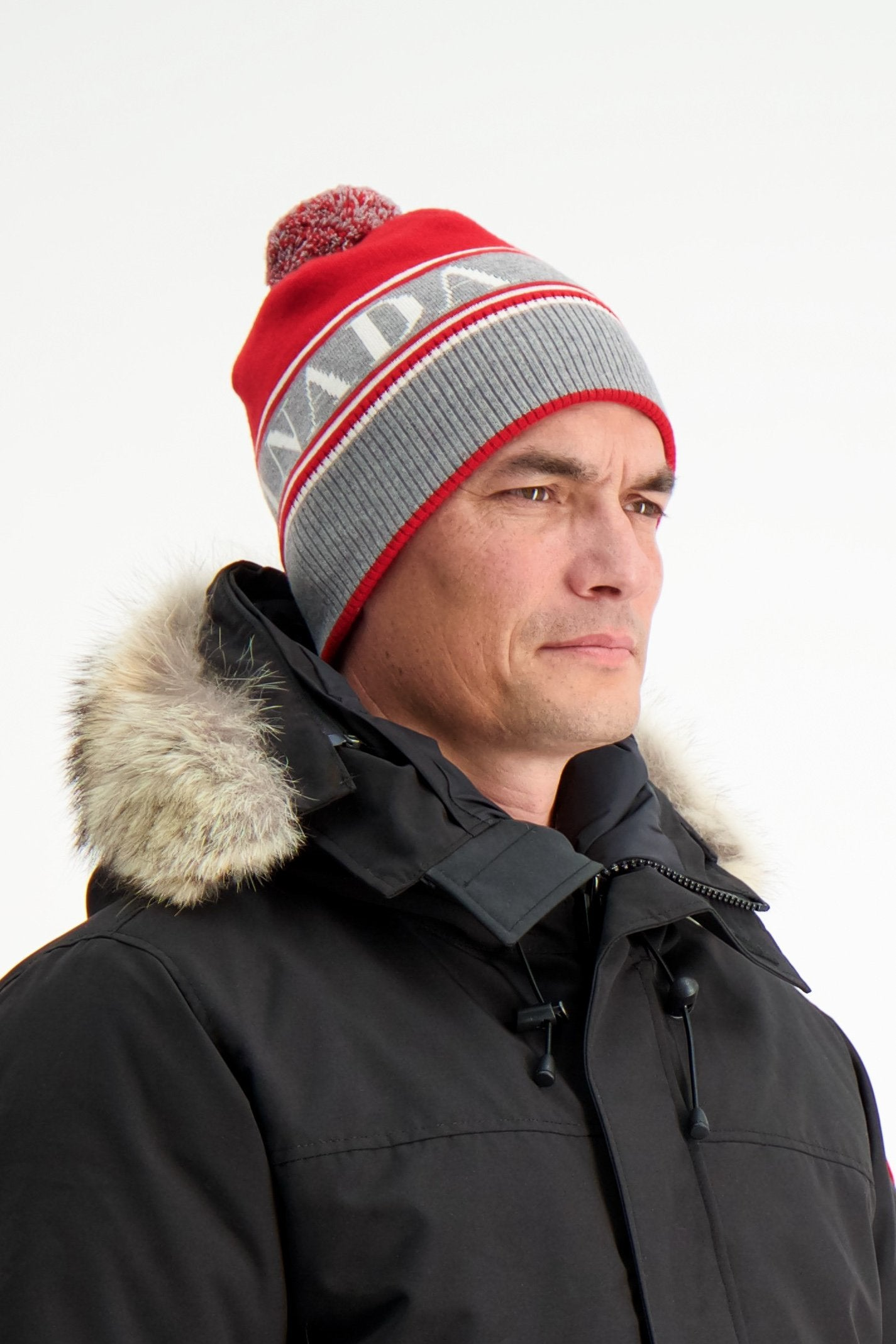 Front Crop Image Of Model Wearing Canada Goose Women's Canada Goose Pom Toque Hat Red
