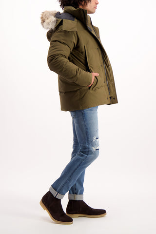 Full Body Image Of Model Wearing Canada Goose Men's Wyndham Parka Military Green