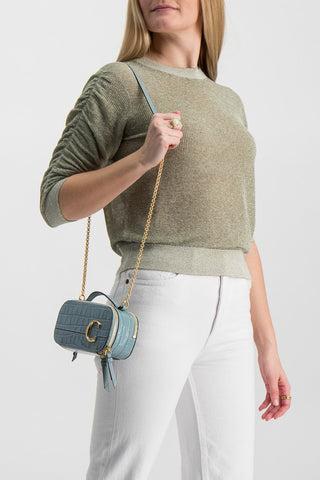 Front Crop Image Of Model Wearing The Chloe C Mini Vanity Bag Faded Blue