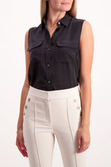 Front Crop Image Of Model Wearing Equipment Sleeveless Slim Signature Blouse