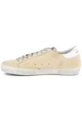 Instep side view image of Golden Goose Men's Superstar Low Top Sneakers Cream Nabuk