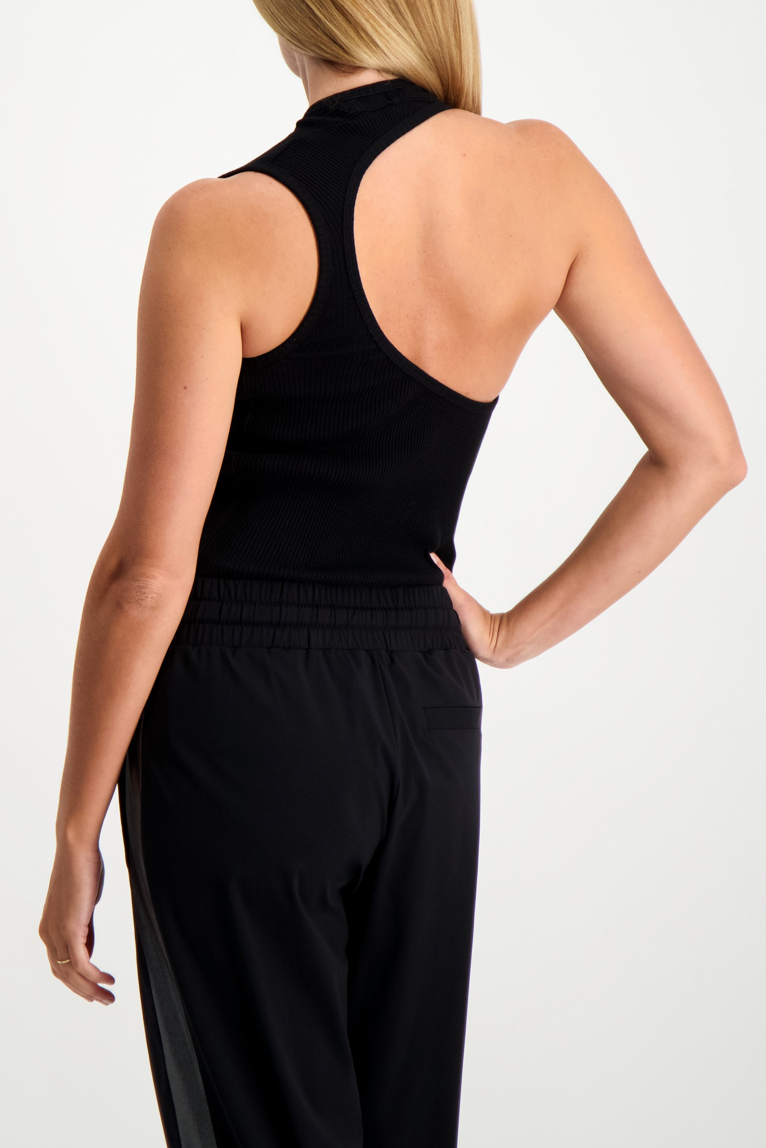 Back Crop Image Of Model Wearing Helmut Lang Asymmetric Tank Black