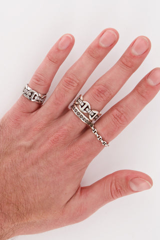Image of Hoorsenbuhs Brute Tri-Link White Diamond Bridges Ring on model's hand