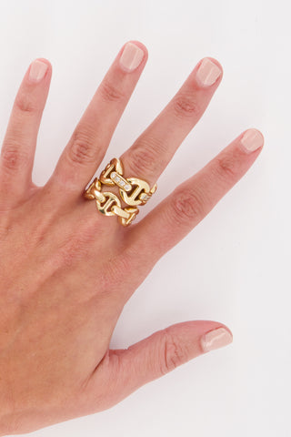 Image of Hoorsenbuhs Quad Link With Diamond Bridges Ring on model's hand