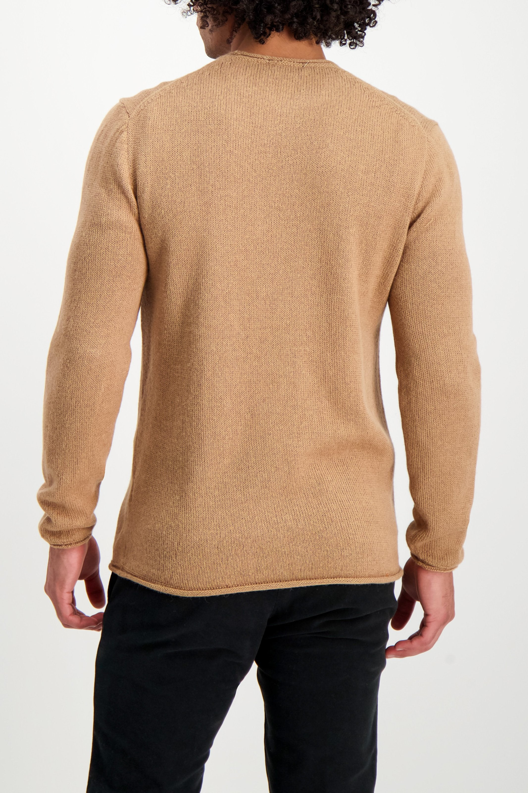 Back Crop Image Of Model Wearing Boiled Alpaca Tunic Sweater Camel