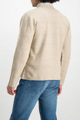 Back Crop Image of Model Wearing Low Mock Neck Tunic Sweater Almond