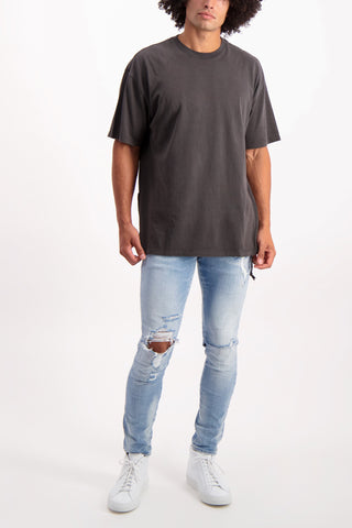 Full Body Image Of Model Wearing KSUBI Biggie Short Sleeve Tee Shirt Black