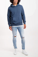 Full Body Image Of Model Wearing KSUBI Chitch Punk Blue Thrashed Denim