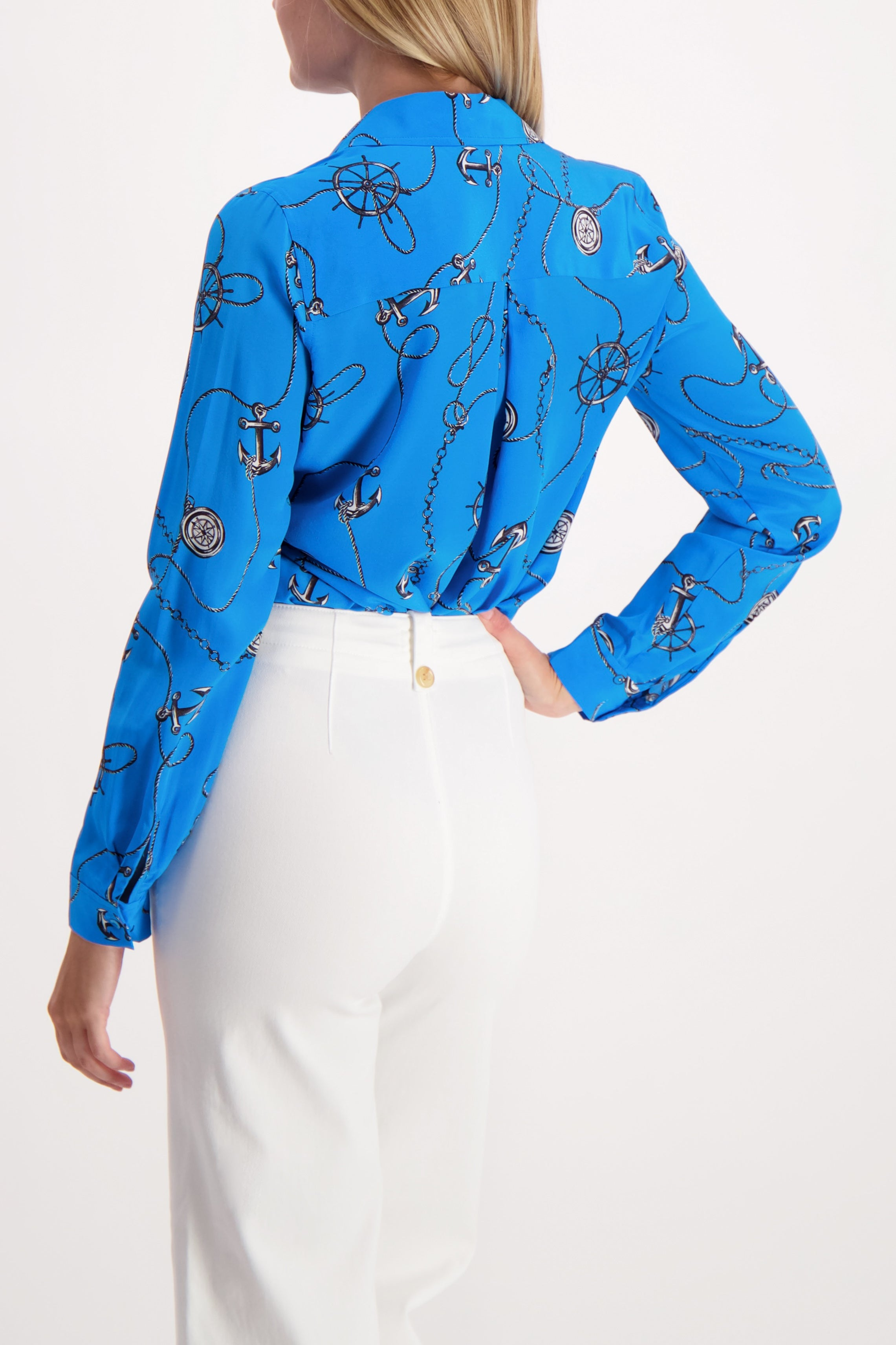 Back Crop Image Of Model Wearing Long Sleeve Nina Blouse Blue