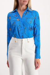 Front Crop Image Of Model Wearing Long Sleeve Nina Blouse Blue