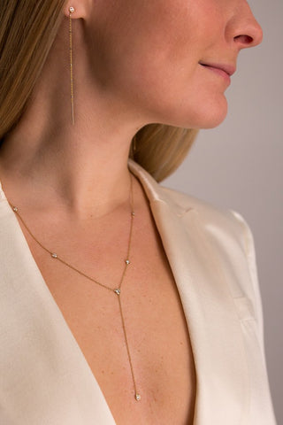 Detail Image Of Model Wearing Diamond Star Droplet With Baguette Lariat