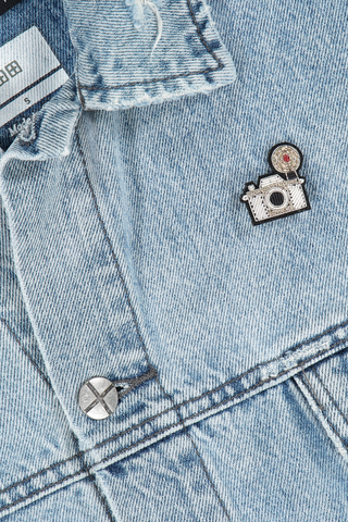 Image of Macon & Lesquoy Silver Camera Pin on jean jacket