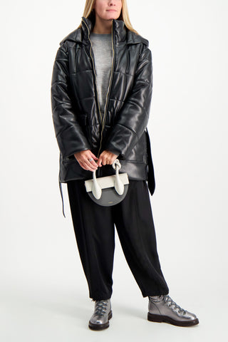 Full Body Image Of Model Wearing Nanushka Lenox Vegan Leather Coat
