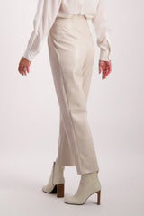 Back Crop Image Of Model Wearing Nanushka Mitsu Trouser Creme