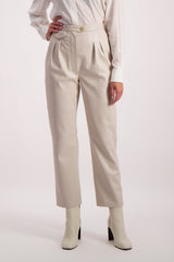 Front Crop Image Of Model Wearing Nanushka Mitsu Trouser Creme