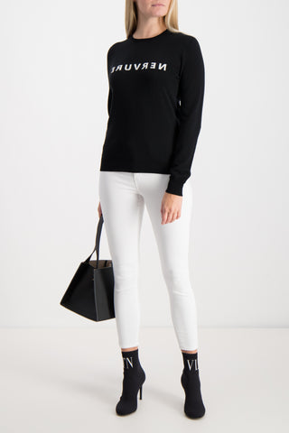 Full Body Image Of Model Wearing Nervure Sweater Nero In Bianco