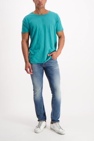 Full Body Image Of Model Wearing Nudie Jeans Roger Slub Tee Turquoise