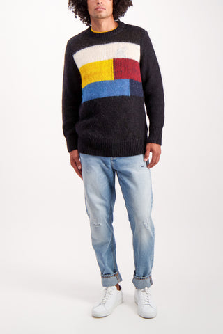 Full Body Image Of Model Wearing Nudie Jeans Hampus Patch Knit