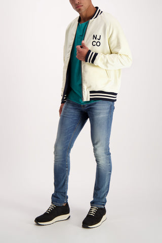 Full Body Image Of Model Wearing Nudie Mark Baseball Jacket
