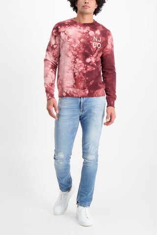 Full Body Image Of Model Wearing Nudie Jeans Melvin Tie Dye Long Sleeve