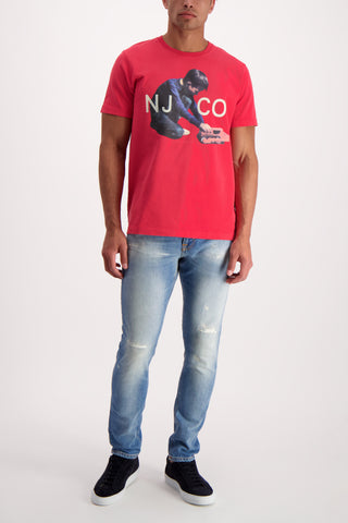 Full Body Image Of Model Wearing Nudie Jeans Roy Logo Boy Tee