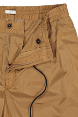 Drawstring, zipper, and button detail of PT Forward Drawstring Jogger Diagonal Pockets Khaki