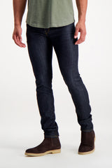 Front Crop Image Of Model Wearing S.M.N. Denim Finn Tapered Slim Bravo