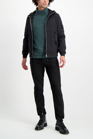 Full Body Image Of Model Wearing Stone Island Black Jacket With Hood