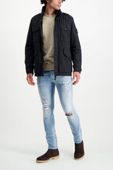 Full Body Image Of Model Wearing Stone Island Black Jacket