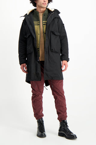 Full Body Image Of Model Wearing Stone Island Coat Detachable Interior Black