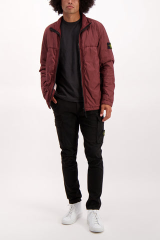 Full Body Image Of Model Wearing Stone Island full zip coat in burgundy