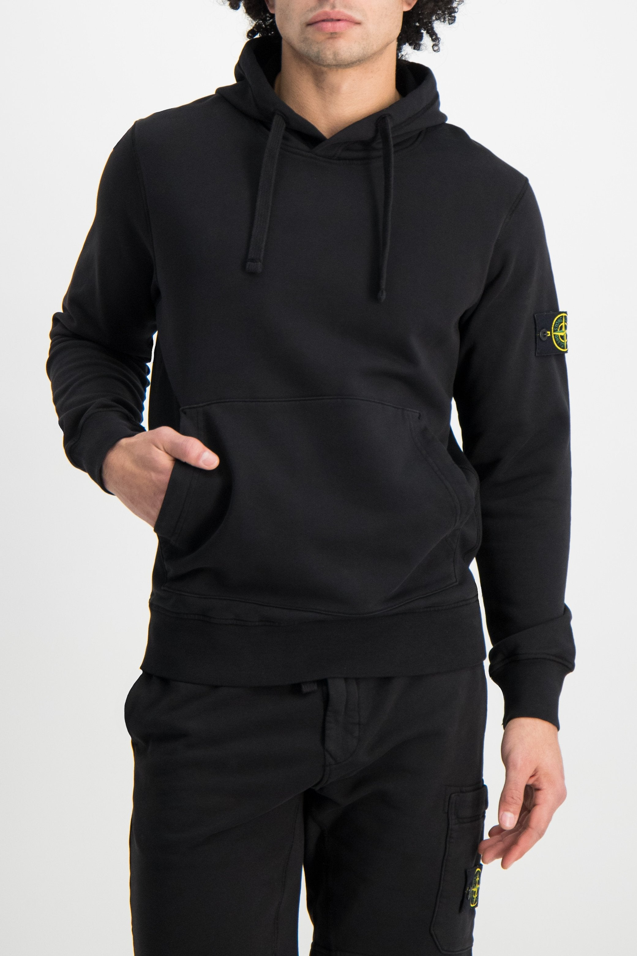 Front Crop Image Of Model Wearing Stone Island Hooded Sweatshirt Black