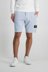 Front Crop Image Of Model Wearing Stone Island Sky Blue Fleece Short