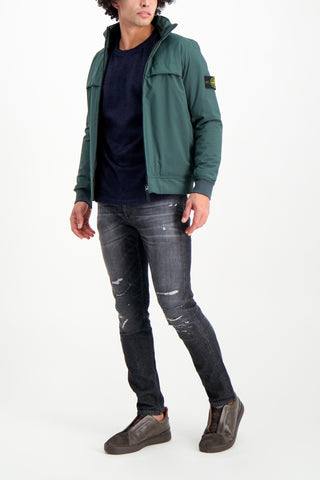 Full Body Image Of Model Wearing Stone Island Soft Shell Jacket Primaloft Insulation Green