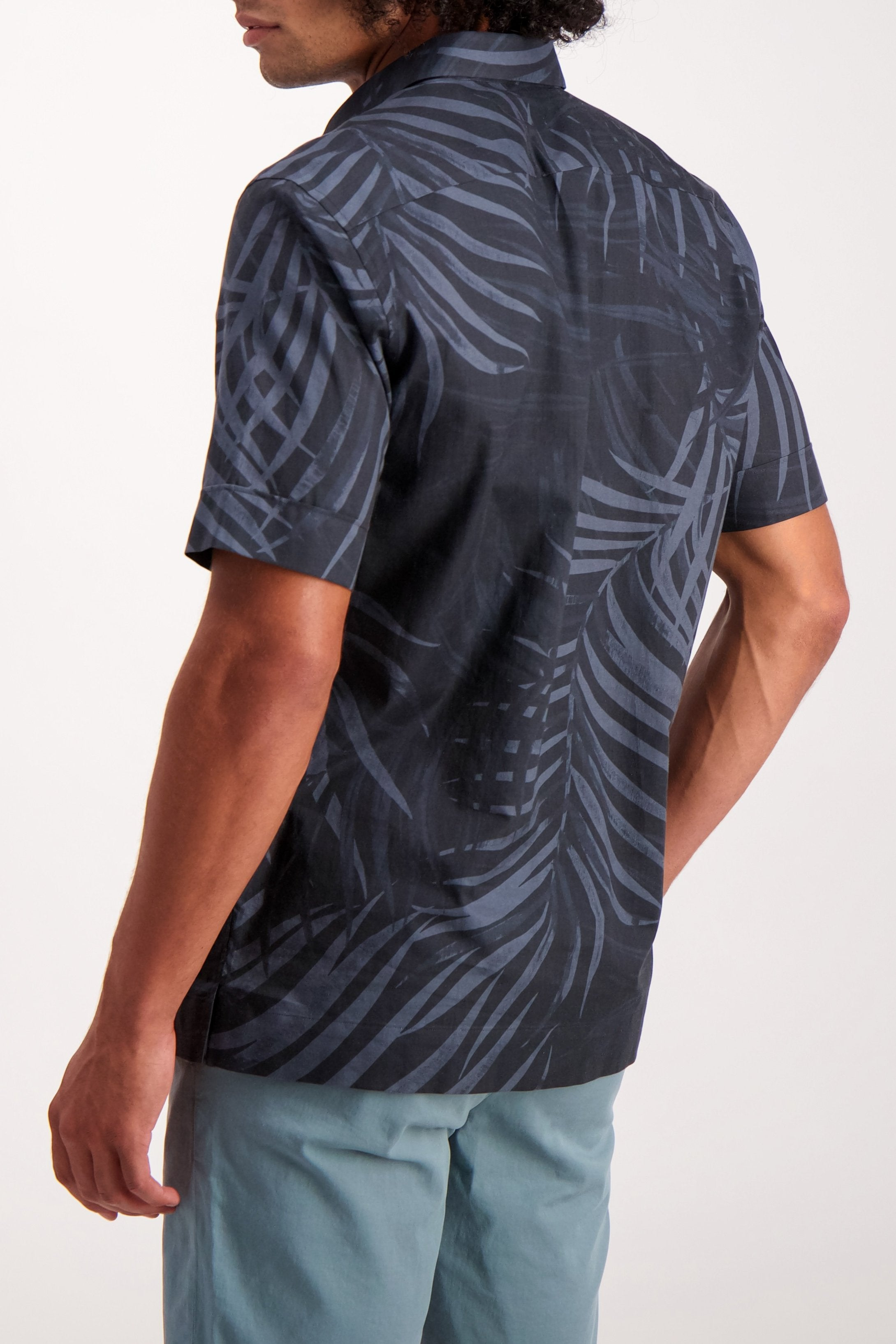 Back Crop Image Of Model Wearing Men's Theory Menlo Printed Leaf Short Sleeve Woven