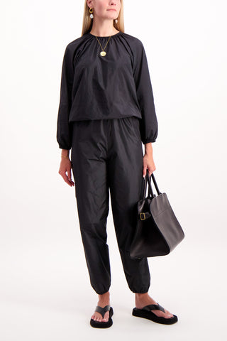 Full Body Image Of Model Wearing The Row Dez Pant