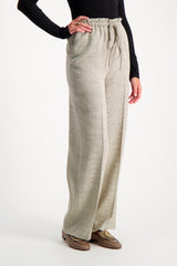 Front Crop Image Of Model Wearing The Row Jr Drawstring Pant