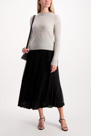 Full Body Image Of Model Wearing The Row Lawrence Skirt