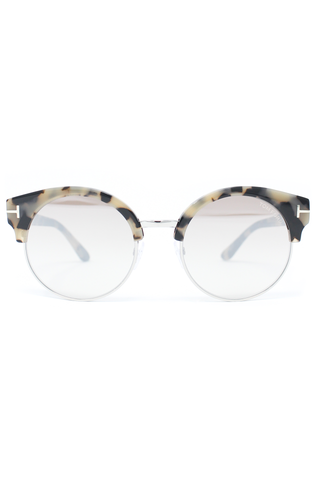 Rounded glasses with blue flash lens with plastic white and black tortise shell frame.