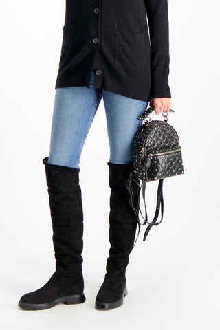 Crop Image Of Model Holding Rockstud Spike Mini Backpack