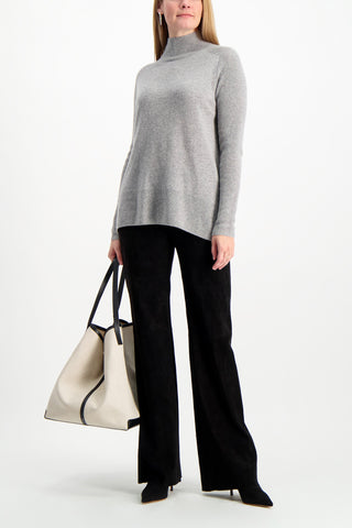 Full Body Image Of Model Wearing White & Warren Eliptical Hem Standneck Sweater Grey