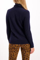 Back Crop image Of Model Wearing white & Warren Essential Turtleneck Sweater Deep Navy
