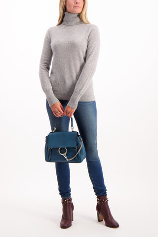 Full Body Image Of Model Wearing Essential Turtleneck Sweater Grey Heather