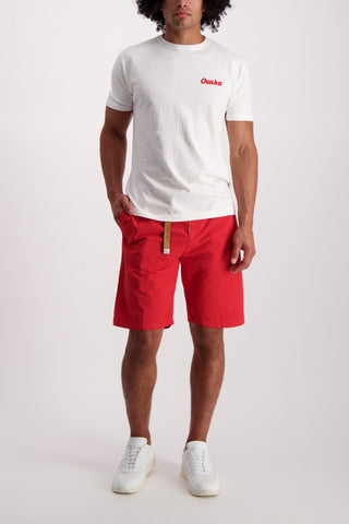Full Body Image Of Model Wearing White Sand Cotton Stretch Short Red