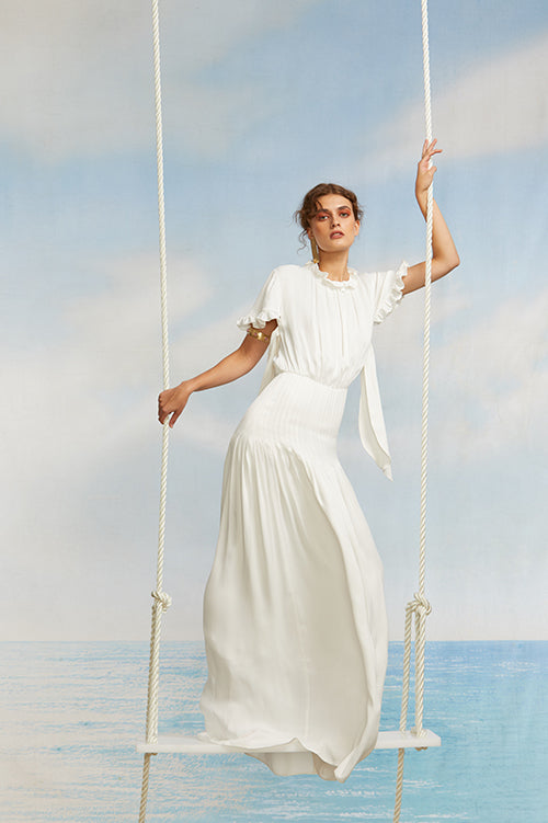 Cynthia Rowley Spring 2018 Look 10 featuring a white silk maxi dress with short sleeves