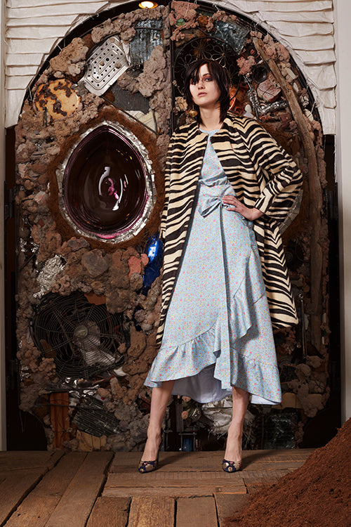 Cynthia Rowley Pre-Fall 2018 Look 11 featuring a light blue floral print cotton ruffle wrap dress with zebra print coat
