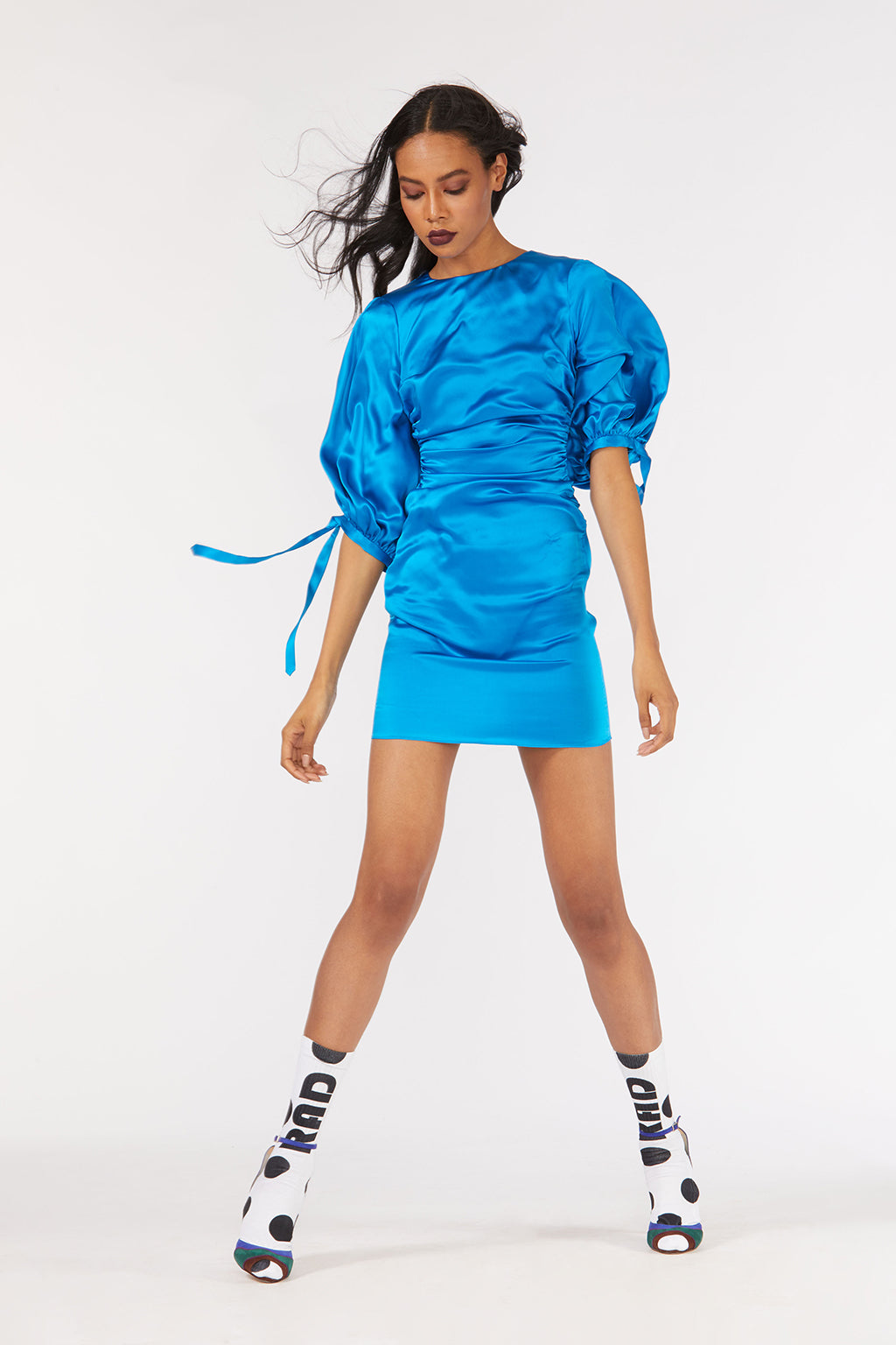 Cynthia Rowley Fall 2018 look 11 featuring a bright blue satin mini dress with oversize puff sleeves.