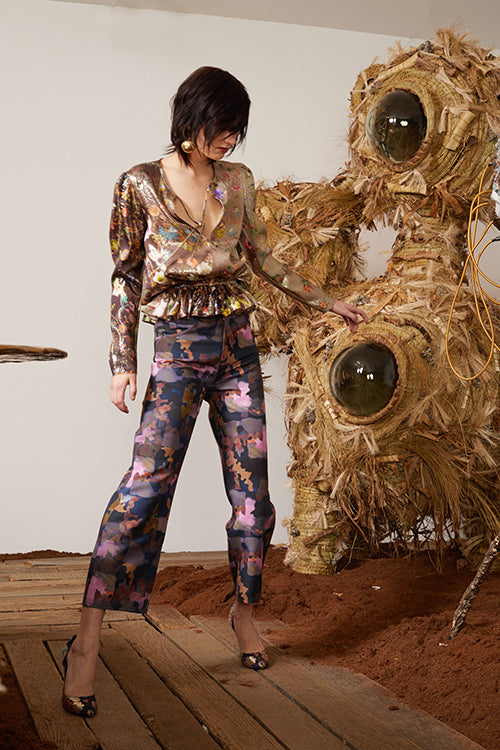 Cynthia Rowley Pre-Fall 2018 Look 12 featuring a long sleeve peplum top in metallic floral print fabric and silk came print pants