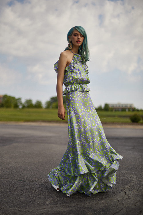 Cynthia Rowley Resort 2019 Collection features a light green and purple floral printed maxi dress finished with ruffles at the bottom of the dress.